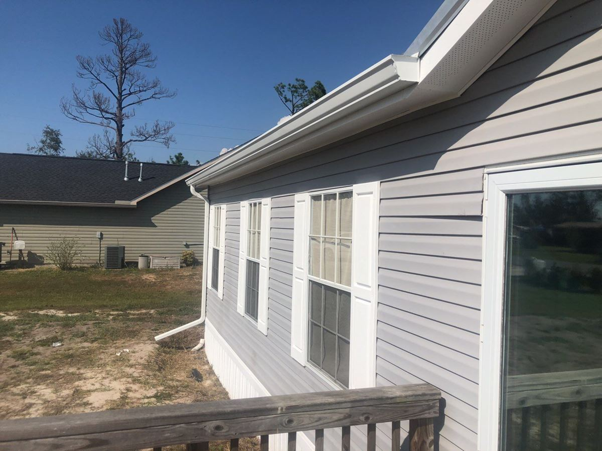 Seamless Gutter Repairs with New Gutter Gaurds Installed in Panama City, FL